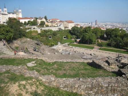 Gallo-Roman Ampitheater in Lyon with modern museum built into hillside behind it.